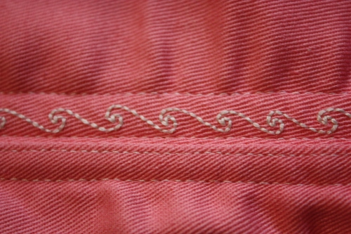 The embroidery detail, showing two boning channels, where only one is embroidered.
