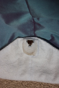 The lead weight sewn into a little square of flannelette, with the hook shown.