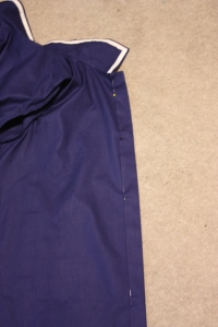 The button placket at the centre front.